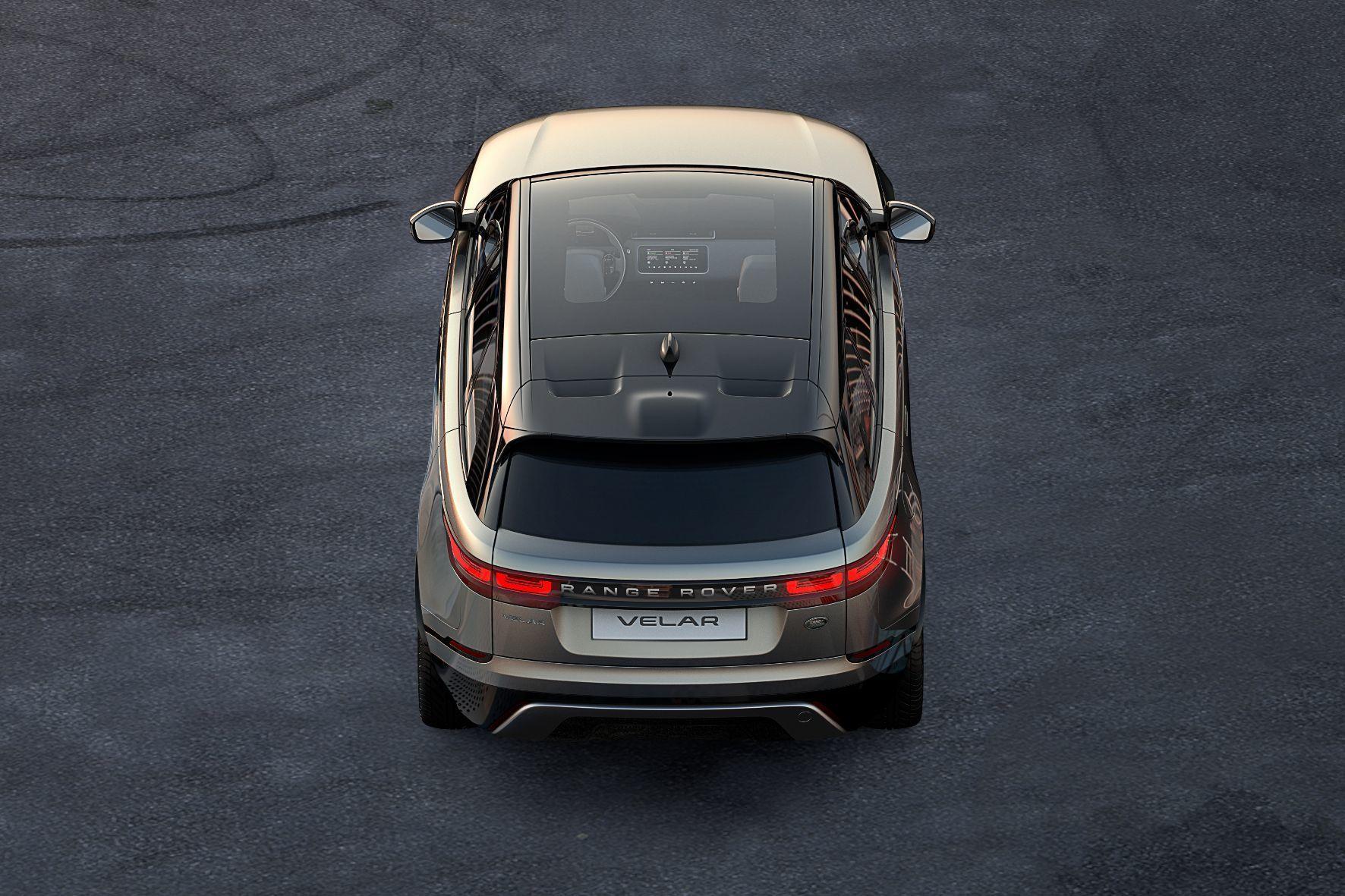 mid Groß-Gerau - Markante Fensterlinie und riesiges Panoramadach: der neue Range Rover Velar in der Heckansicht.